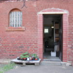 Gitarrenbau Christian Stoll: 2008: Eingang zur Reparaturwerkstatt und den Ausstellungsräumen